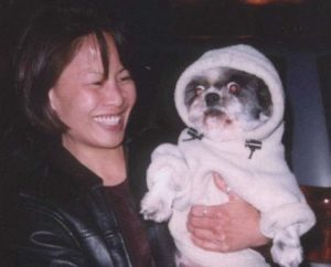 Karen Tsang and puppy in a hoodie