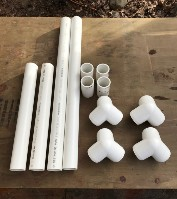 PVC pipes and fitting laid out on table