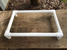 photo of assembled bed frame on table
