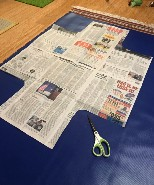 newspaper template laid over vinyl fabric